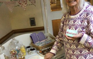 Norma Lebihan, resident at Care UK's Mill View, enjoys the 'Mill View Sweet Memories' trolley as part of the Food for Thought campaign